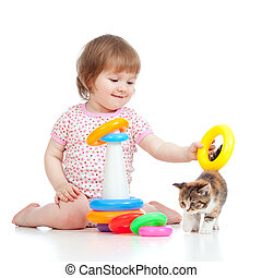 adorable child playing with kitten