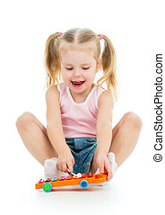 adorable child playing with musical toy