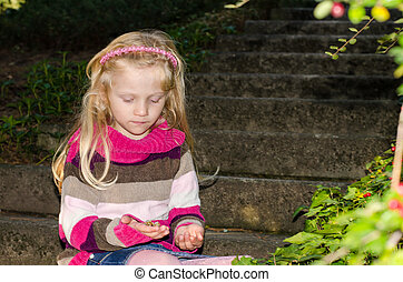 adorable child sitting in the stairs