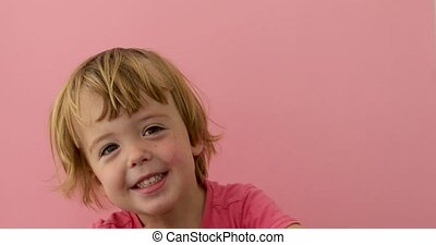 Adorable child smiling at camera - Cute merry light haired...