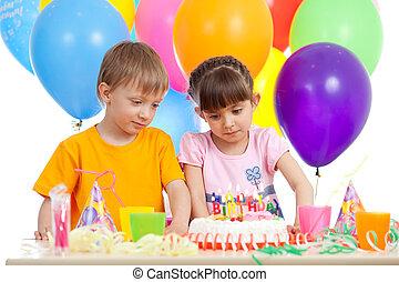 adorable children celebrating birthday party