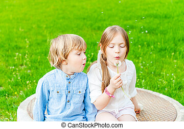 Adorable children having fun outdoors on a nice sunny day