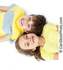 Adorable children lying on the floor