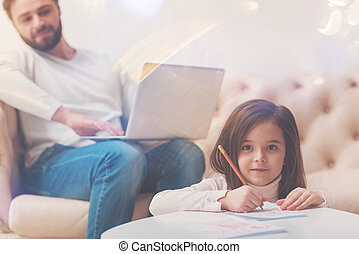 Adorable creative girl spending time with dad