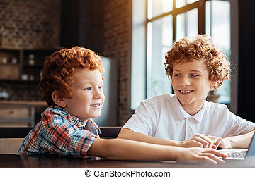 Adorable curly haired brothers spending time together