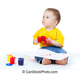 Adorable dirty child with paints