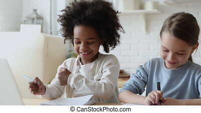 Adorable diverse ethnicity kid girls playing doing homework ...