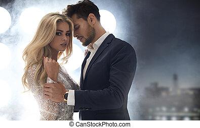 Adorable, elegant lady seducing her handsome boyfriend -...