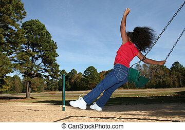 swing - Adorable five year old African American Girl at park...