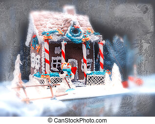 Adorable gingerbread cottage, a sprig of Christmas tree and a sugar mastic snowman on dark background in frozen window