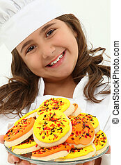 Adorable Girl in Chef Uniform with Iced Thanks Giving Day