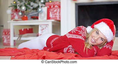 Adorable girl in Christmas outfit lying on the floor