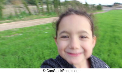Adorable girl in green field - Shot of Adorable girl in...