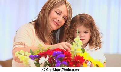 Adorable girl making a bunch of flowers
