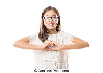 Adorable girl making the heart with her hands, Isolated on white