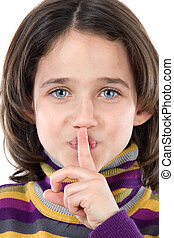 Adorable girl ordering silence on a over white background