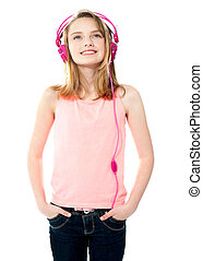 Attractive teenager listening to music on her music player