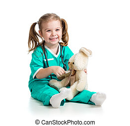 Adorable girl with clothes of doctor spoon playing with toy over white