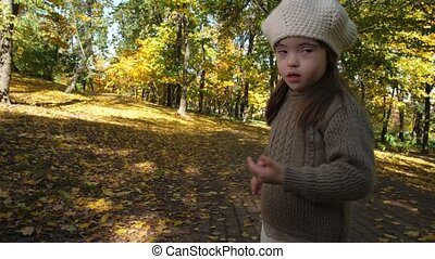Adorable girl with down syndrome dancing in nature