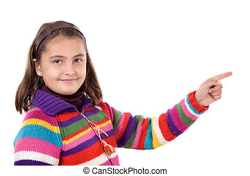 Adorable girl with woollen jacket pointing on a over white background