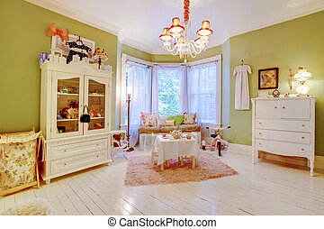 Adorable girls room with play area by the window