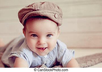 Adorable happy baby boy in a bright room