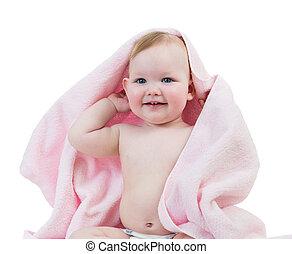 Adorable happy baby girl in towel
