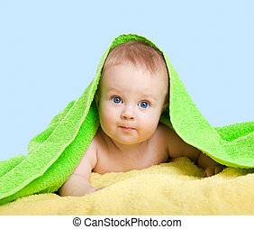 Adorable happy baby in colorful towel
