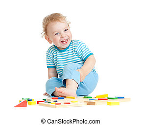 Adorable happy child playing educational toys isolated on white