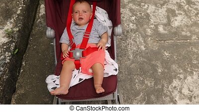 Adorable infant baby in stroller - From above shot of little...