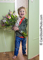 Adorable kid with flowers