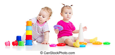 Adorable kids playing with colorful towers isolated on white