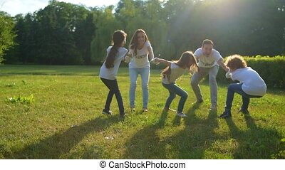 Adorable kids playing with volunteers outdoors - Having fun...