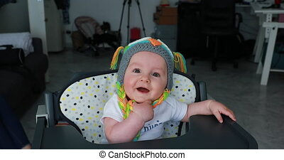 Adorable Little Baby Boy With A Funny Wool Hat On The Head