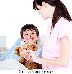 Adorable little boy attending a medical exam