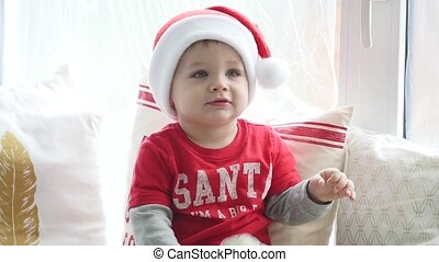 Adorable little boy playing with Christmas decorations and luminous garland at home. Photoshoot with Flash Light