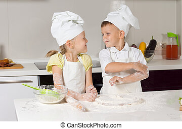 Adorable Little Chefs Playing at Kitchen
