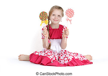 adorable little girl 8 year old with candy sweet on white...