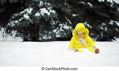 Adorable little girl at snow weather outdoors on beautiful winter day
