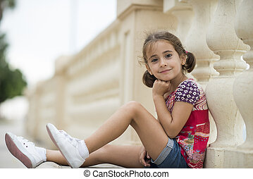 Adorable little girl combed with pigtails