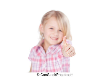 Adorable little girl giving a thumbs up