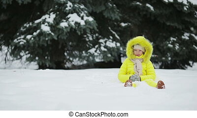 Adorable little girl having fun during winter vacation