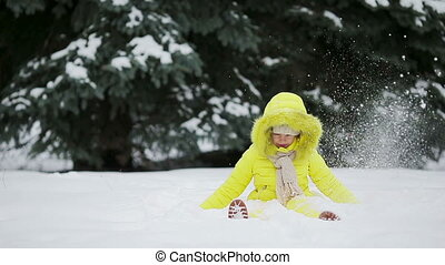 Adorable little girl having fun on winter day outdoors