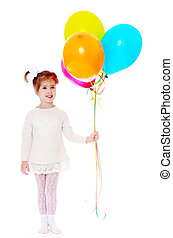 Adorable little girl holding a bunch of balloons