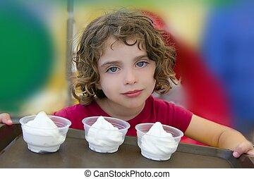 Adorable little girl holding three ice cream