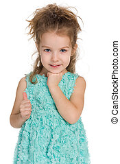 Adorable little girl holds her thumb up