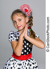 Adorable little girl in a fashion dress
