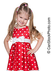 Adorable little girl in a red dress