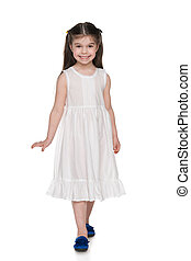 Adorable little girl in a white dress