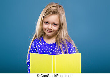 Adorable little girl in purple dress hold empty book